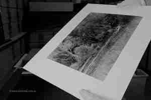 Preparing a fibre base print for dry mount press